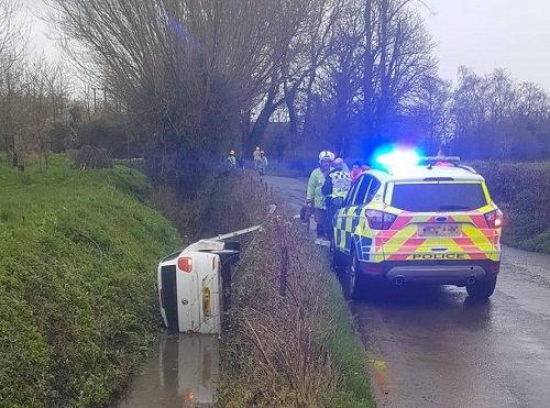 Car plunges into flooded ditch after coming off the road